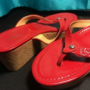 Red patent leather wedge COACH sandals